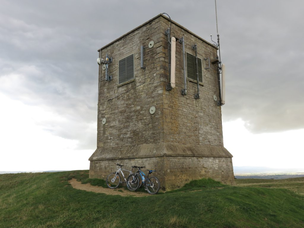 bikes leaning against bredon hill stone tower