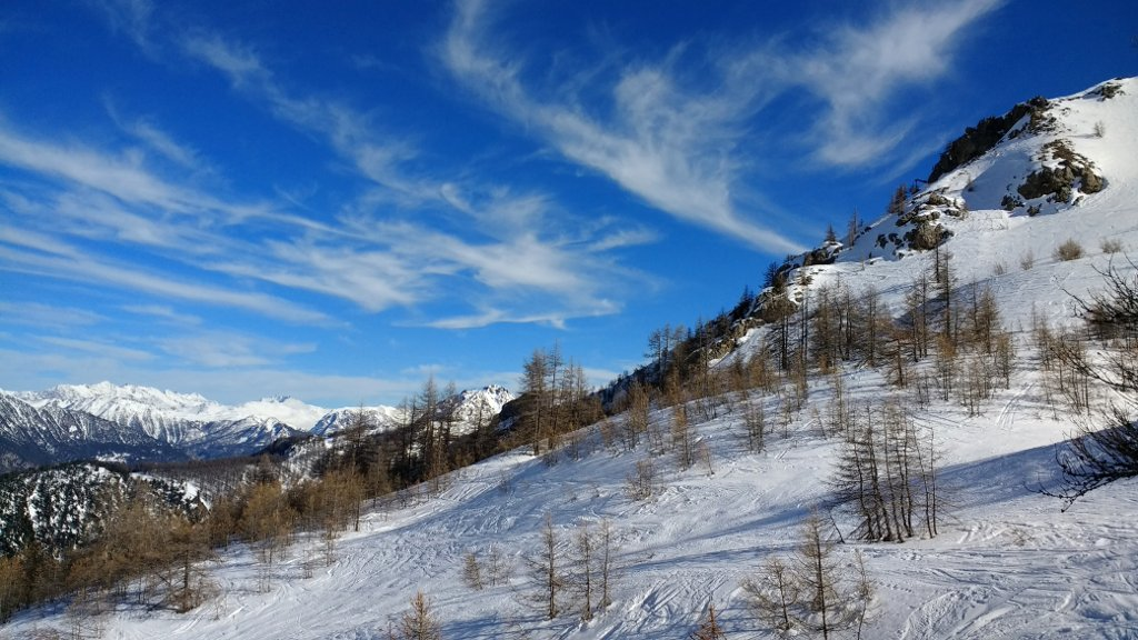 blue sky, fluffy clouds, and soft snow