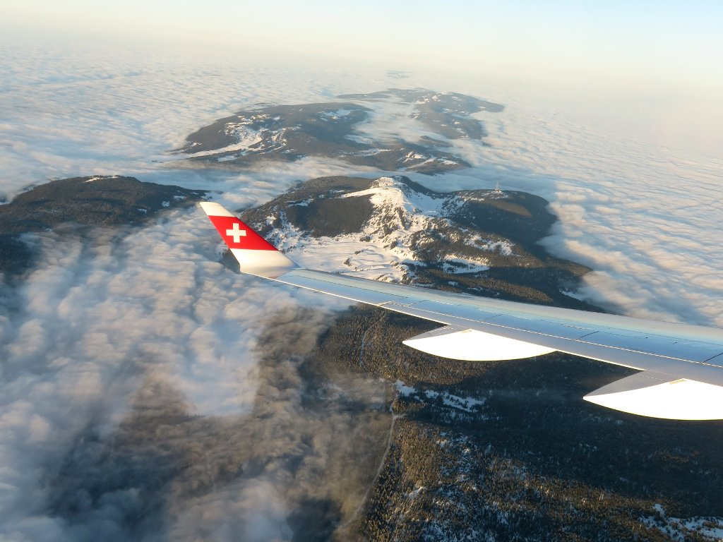 flying above the clouds coming into Geneva